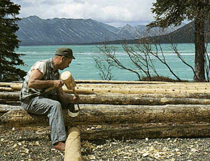 Alone in the wilderness - Dick Proenneke - notching logs for wall
